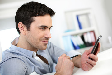 Profile view of man connected on smartphone