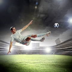 football player striking the ball