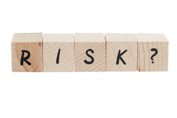 Word Risk Written With Wooden Blocks.