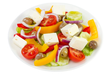 vegetable salad with cheese on the plate on white background