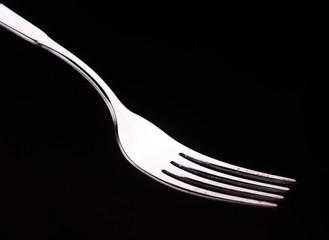 Empty fork on a black background