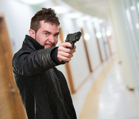 angry man pointing with gun