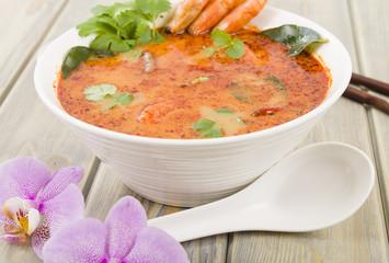 Tom Yum Nam Khon - Creamy Thai soup with prawns and mushrooms.