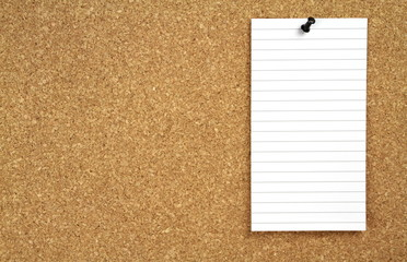 Cork notice board and white blank note papers