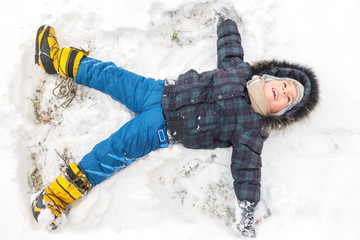 Llittle boy having fun on winter day