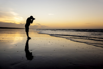 photographer at the sunset beach