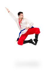 Man wearing a folk ukrainian costume jumping