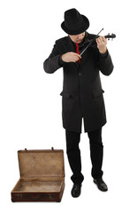 Street musician with violin and open old suitcase