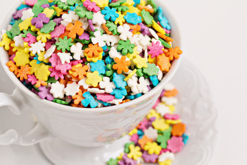Colorful sprinkles in white cup