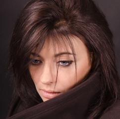 Artistic portrait of brunette on a dark background