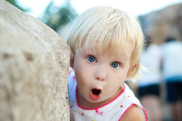 surprised girl by the stone