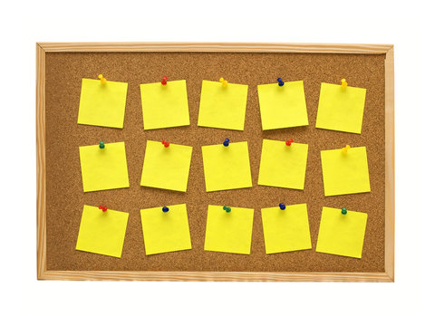 office cork board with yellow post it notes