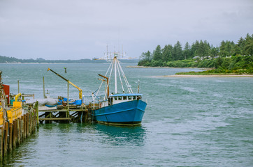 Fishing Boat at Dock Being Unloaded
