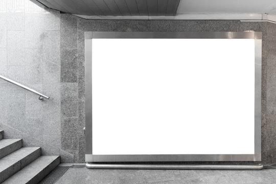 Blank billboard in underground hall