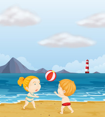 A girl and a boy playing volleyball at the beach