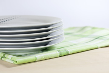 Plates on tablecloth in kitchen abstract food background