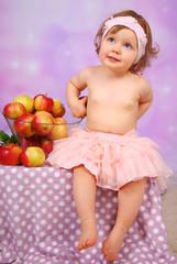 little baby girl hiding  apples