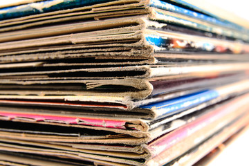 Stack of vinyl records in covers made of paper