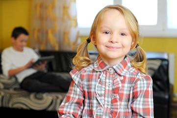 Smiling little girl in room