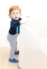 standing little boy with a toy