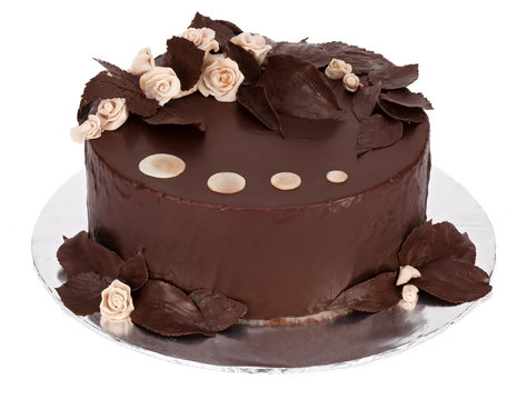 Decorated chocolate cake on round plate
