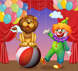 A lion and a clown at the circus