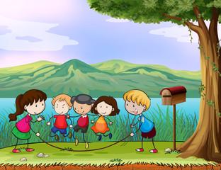 Fotobehang Honden Kids playing near the wooden mailbox