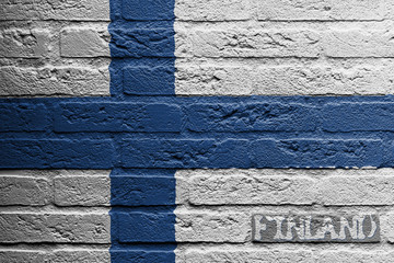 Brick wall with a painting of a flag, Finland