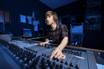 Man using a Sound Mixing Desk