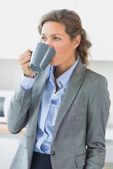 Woman having coffee before work