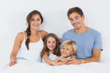 Family sitting on the bed