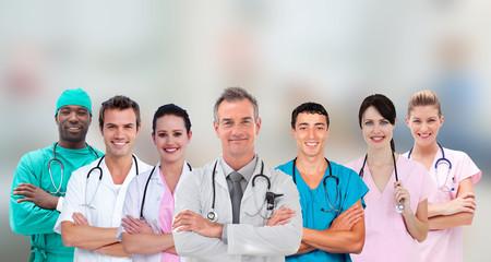 Medical team standing arms crossed in line