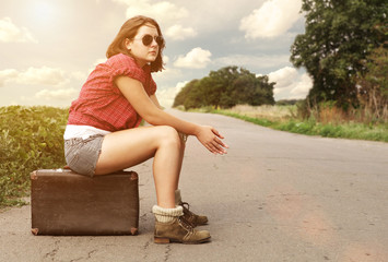 Young girl on the empty highway