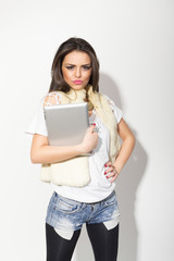 Fashionable student girl with digital tablet