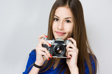 Young brunette girl using camera.