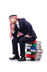 Arab businessman with many folders on white