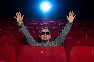 Funny  man in 3D glasses watching movie in cinema