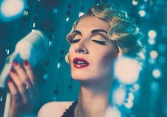 Elegant blond retro woman singer
