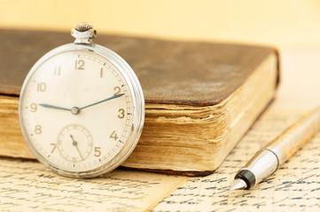 Antique book and clock