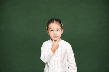 smart girl thinking, chalkboard background