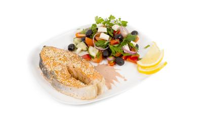 Seasoned salmon steak and salad