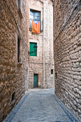 Catalan flags placed on balcony on street in Girona, Spain.