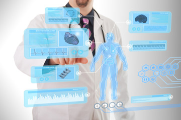 Male doctor working on a futuristic touchscreen display