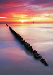 Fototapete - Beach in Poland - Baltic sea at sunrise