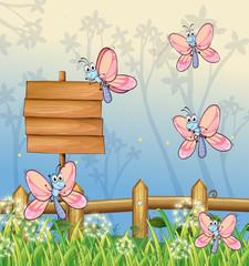 Keuken foto achterwand Vlinders Five butterflies near an empty board