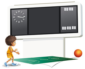 A boy playing basketball with a scoreboard