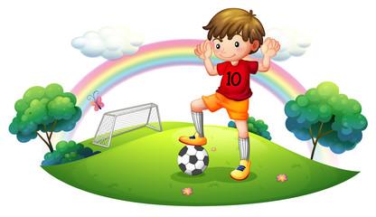 A boy in a soccer field