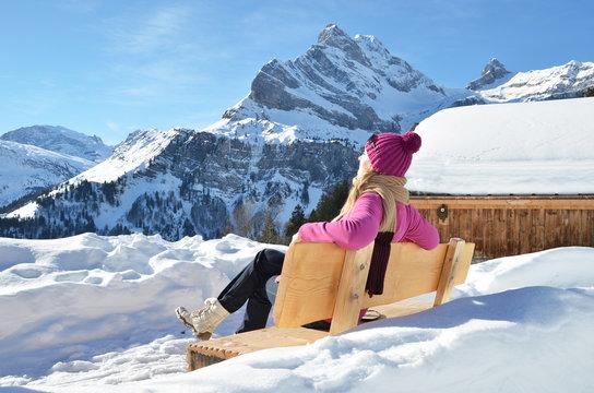 Traveler enjoying Alpine panorama. Switzerland