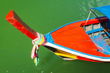 Traditional red long tail boat on the water of Thailand