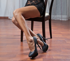 Long Woman legs in stockings on sofa. sexy women legs on sofa .